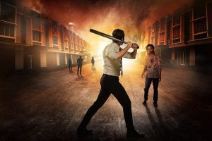 A man with a baseball bat faces off zombies in a burning city.