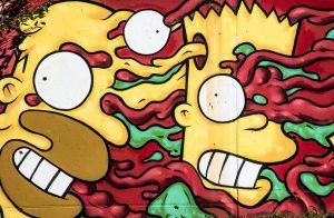 Abstract graffiti of Bart and Homer Simpson with their faces appearing to melt into one another's amid blue and red slime/tendrils.