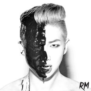Album cover for RM, black and white image of the singer with thick black paint dripping down one side of his face.