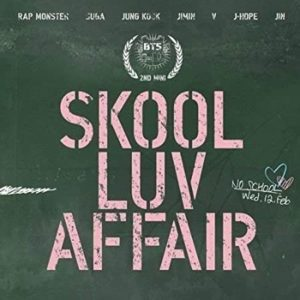 Album cover for Skool Luv Affair by BTS, blackboard background with pink stenciled chalk typography.