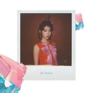 Album cover for Palette by IU featuring a Polaroid of the singer with paint brushstrokes.