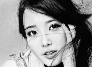 Korean pop star IU with head propped in hand, black and white.