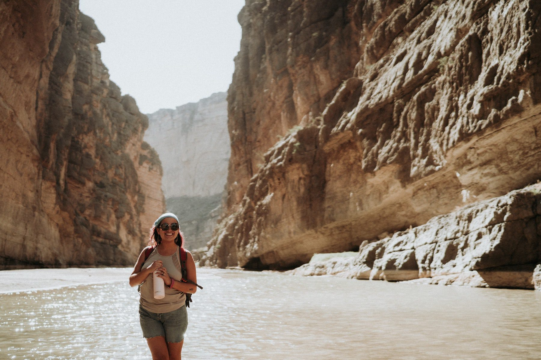 Hiker smiling in a valley at Big Bend National Park.